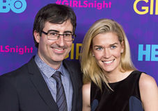 John Oliver and Kate Morley. British comedian John Oliver and wife Kate Morleyarrive on the red carpet for the New York premiere of the third season of the hit royalty free stock photo