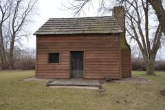John Patton Log Cabin. This is a picture of the John Patton Log Cabin in Lexington, Illinois.  The house was built by John Patton, is an example of Log Royalty Free Stock Photo