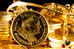 John Paul II coin with Jewels and gold coins. Over dark background stock photos