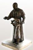 John Paul II statue with girl. John Paul II statue and little girl keeping pigeon Stock Photos