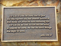 John 3:16-17. A plaque at the Creation Museum on a stone that has John 3:16-17 on it royalty free stock photography