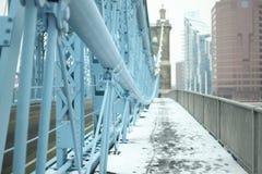 John A. Roebling Suspension Bridge in the winter snow in Cincin stock image