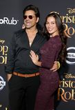John Stamos and Caitlin McHugh. At the Los Angeles premiere of `Christopher Robin` held at the Walt Disney Studios in Burbank, USA on July 30, 2018 stock images