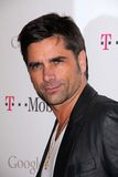 John Stamos, Mr Brainwash. John Stamos at Google And T-Mobile Celebrate The Launch Of Google Music, Mr. Brainwash Studios, Los Angeles, CA 11-16-11 stock image