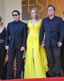 John Travolta y Uma Thurman y Quentin Tarantino Fotos de archivo
