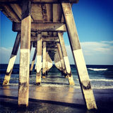 Johnnie Mercer`s Pier. A view from underneath Johnnie Mercer`s Pier, in Wrightsville Beach, NC stock photos