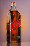 Johnnie Walker Red Label blended whisky on gradient background. Royalty Free Stock Photography