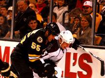 Johnny Boychuk and Cody McLeod battle for the puck Stock Images