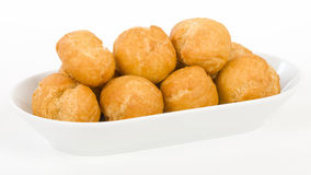 Johnny Cakes. Jamaican fried dumplings in a white bowl Stock Photos