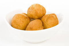 Johnny Cakes. Jamaican fried dumplings in a white bowl Royalty Free Stock Image