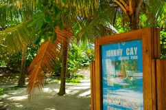 JOHNNY CAY, COLOMBIA - OCTOBER 21, 2017: Informative sign under a palm trees in Johnny Cay, Island of San Andres. Colombia Stock Image