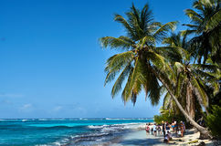 Johnny Cay island. JOHNNY CAY, COLOMBIA - JANUARY 09, 2015: Some people walking on the beach in the coast of Johnny Cay island Royalty Free Stock Photo