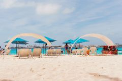 Johnny Cay`s Beach. Tourists, chairs and umbrellas at Johnny Cay`s Beach Royalty Free Stock Photos