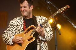 Johnny Clegg performing on stage Stock Images