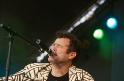 Johnny Clegg performing on stage Stock Photos