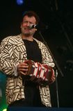 Johnny Clegg performing on stage Stock Photo