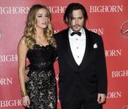 Johnny Depp και Amber που ακούονται Στοκ εικόνα με δικαίωμα ελεύθερης χρήσης