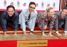 Johnny Galecki, Jim Parsons, Kaley Cuoco and Simon Helberg. At the handprints ceremony for `The Big Bang Theory` held at the TCL Chinese Theatre IMAX in stock image