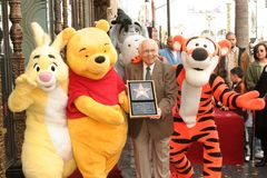 Johnny Grant. Winnie The Pooh and Johnny Grant at the ceremony honoring the Disney Character with a star on the Hollywood Walk of Fame. Hollywood Boulevard Stock Image