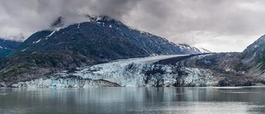 Johns Hopkins Glacier and mountains on a cloudy day in Glacier Bay, Alaska stock images