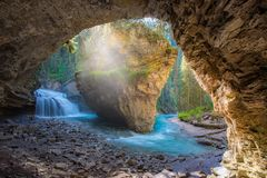 Johnston Canyon cave in Spring season with waterfalls, Johnston Canyon Trail, Alberta, Canada stock photography