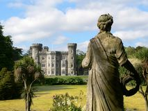 Johnstown Castle. Wexford, Ireland with foreground statue Royalty Free Stock Photography