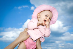 Joie de vivre.bis. Laughing baby jumping against a blue sky Stock Photography