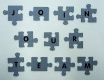 Joignez notre concept d'équipe, puzzle sur le fond blanc photos libres de droits