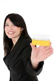 Join the club. Beautiful smiling woman holding a membership card, bank or credit card, business card etc
