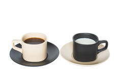 Join diversity. Two coffee cups,  beige and black with coffee and milk, isolated on white Stock Image