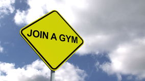 Join a gym sign against blue sky