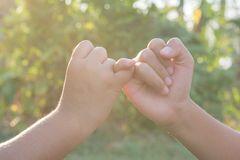 Join hands Sporting local children in nature stock images