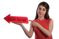 Join now arrow banner on hand. Join now arrow banner on the beautiful young woman hand and pointing by finger isolated over white background stock photos
