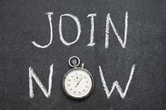 Join now. Concept handwritten on chalkboard with vintage precise stopwatch used instead of O Royalty Free Stock Image