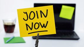 Join now. Jaoin now written on a memo at the office royalty free stock images