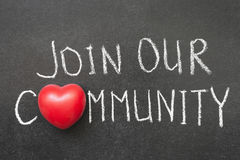 Join our community. Phrase handwritten on blackboard with heart symbol instead of O royalty free stock image