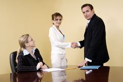 Join our team!. Business people smiling happy to have signed an agreement Stock Photo