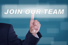 Join our Team. Businessman pushing button for Join our team Royalty Free Stock Photo