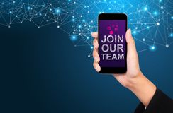 Join our team concept. Join our team on smartphone screen in bus. Inesswoman hand stock images