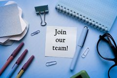 JOIN OUR TEAM CONCEPT. Office workplace top view, copy space. Flat lay office table desk.Labor market concept. Job vacancy,new recruitment, trainee, occupation stock image