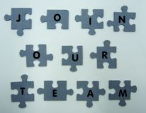 Join our team concept, puzzle on white background royalty free stock photos