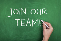 Join Our Team. Hand writing join our team on blackboard Royalty Free Stock Photo