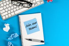 Join our team - Invitation Support Business Concept. Message at workplace with keyboard, glasses and empty space for. Text Royalty Free Stock Photos