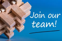 Join our team - message at blue background near macroviewed brain teaser. Hiring and new job concept.  stock images