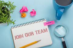 Join our team. Office desk table with notepad, pencil and coffee cup. Top view. Royalty Free Stock Images