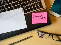 Join our team to be message in the letter on the wooden table royalty free stock image