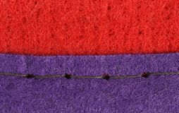 Join of red and blue fabric. Royalty Free Stock Photography