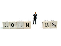 Join us !. An employee standing behind the words join us stock photography