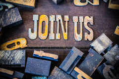Join Us Concept Rusty Type. The words JOIN US written in rusted metal letters surrounded by vintage wooden and metal letterpress type Stock Photos