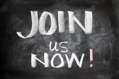 Join us now. Written on a blackboard Royalty Free Stock Photo